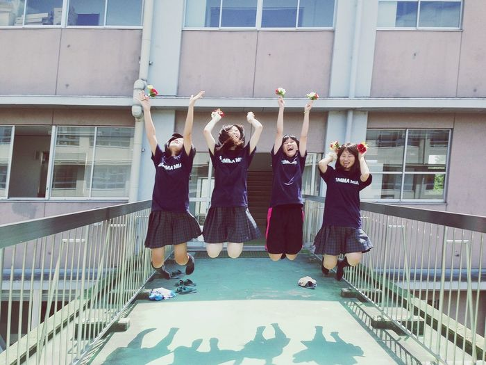 Jumping At School Friends