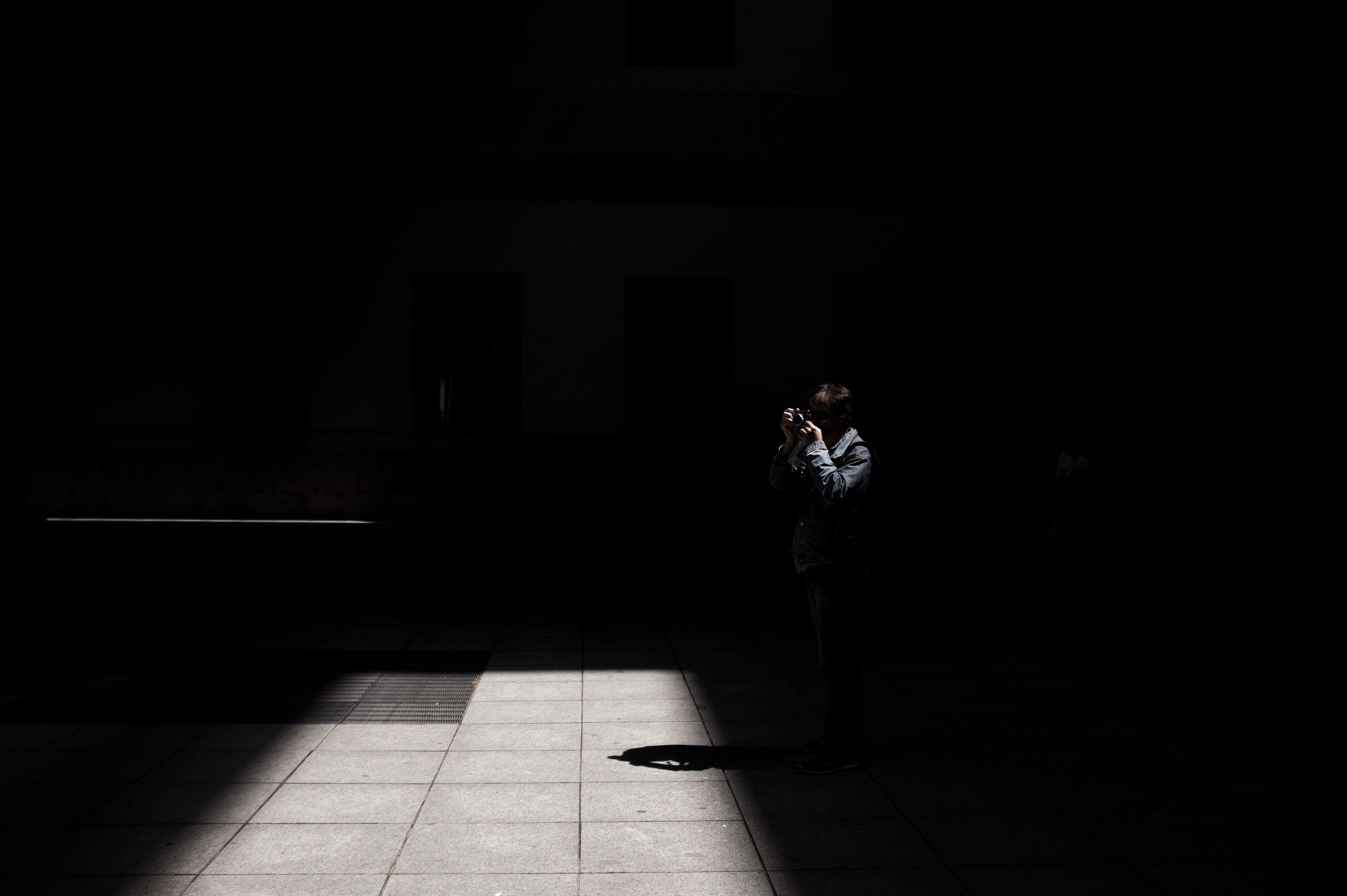 indoors, shadow, sunlight, tiled floor, built structure, architecture, flooring, night, dark, silhouette, illuminated, empty, walkway, corridor, floor, no people, wall - building feature, the way forward, footpath
