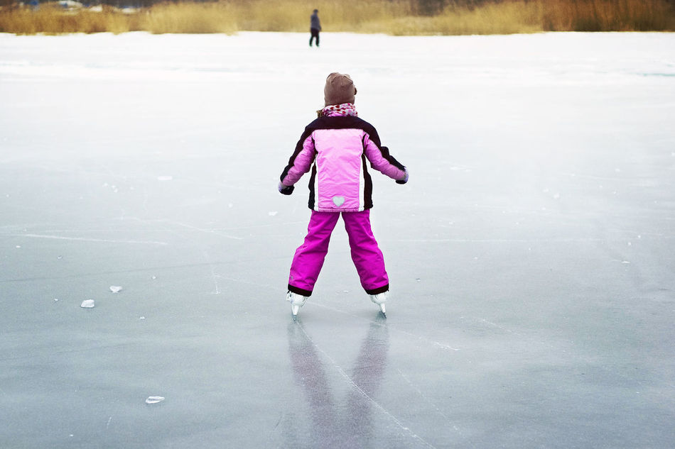 Freedom Freedom! Frozen Frozen Lake Frozen Landscape  Frozen Nature Frozen World Group Of People Have Fun Ice Field Ice Skating Ice-skating Kid Skating Lake Balaton, Hungary One Person Outdoor Activities Outdoors Pink Color Skating Vast Vastness Water Winter Winter Sports Winter Time