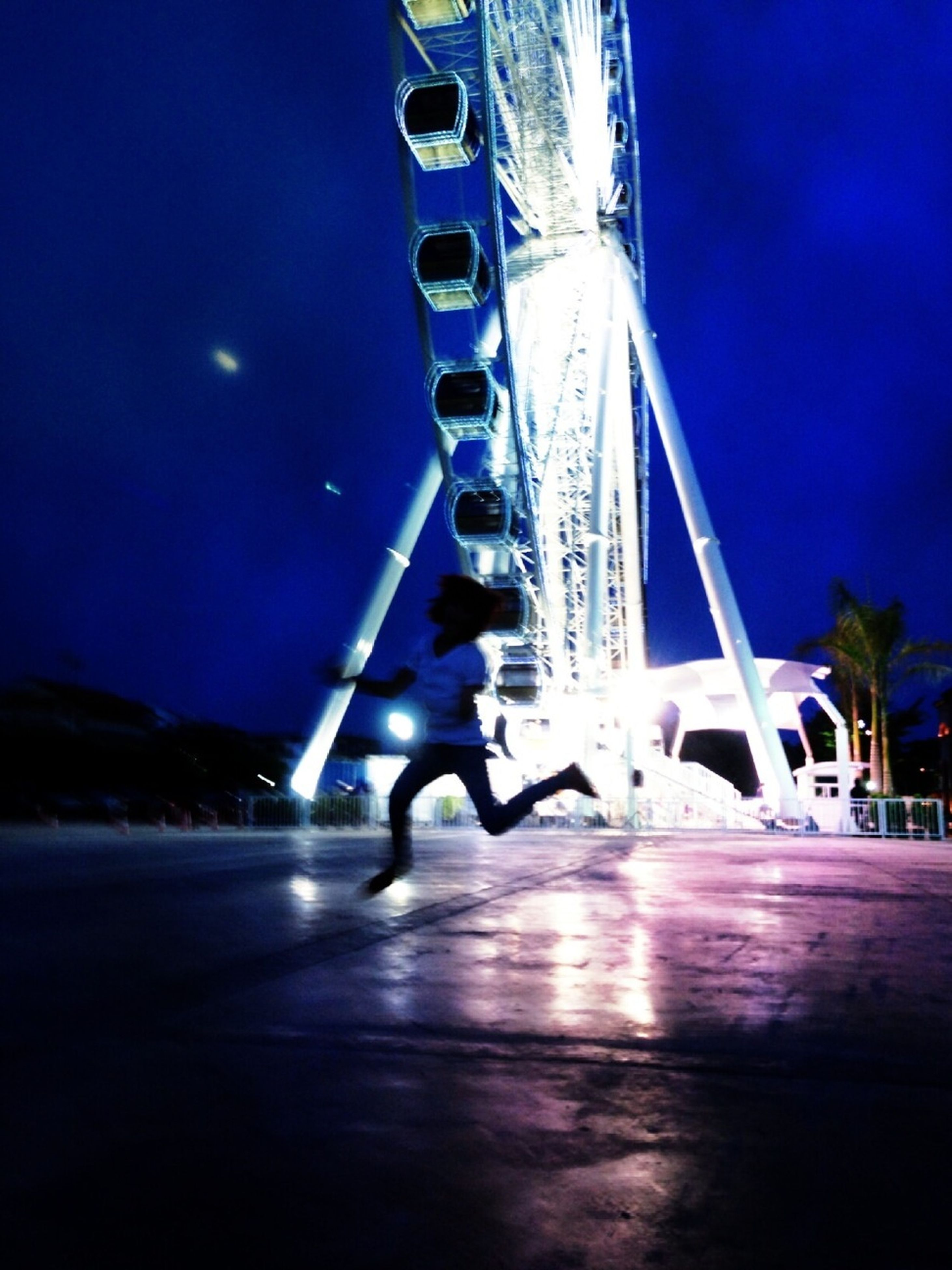transportation, bridge - man made structure, mode of transport, blue, night, clear sky, connection, illuminated, engineering, bridge, river, sky, built structure, nautical vessel, arts culture and entertainment, travel, outdoors, water, amusement park, architecture