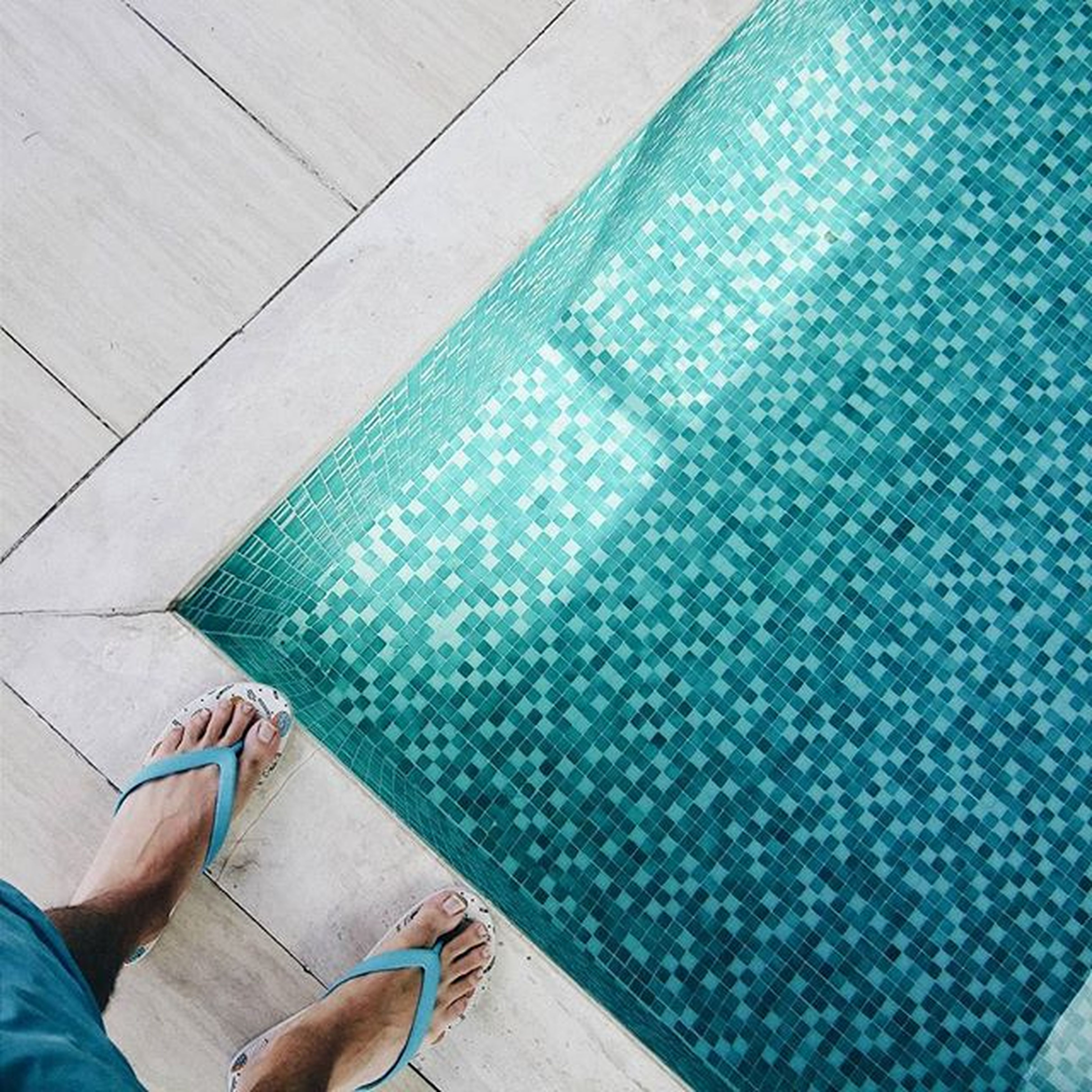 low section, person, lifestyles, personal perspective, high angle view, leisure activity, part of, human foot, indoors, blue, unrecognizable person, cropped, men, swimming pool, relaxation