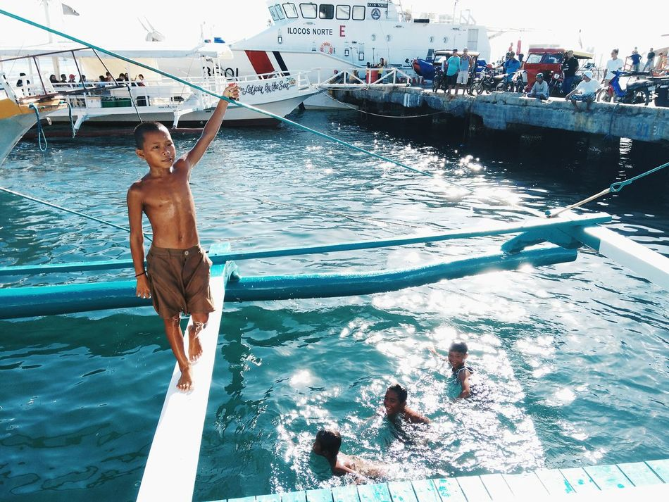 A group of young sea gypsies diving for coins. Many of the passengers tried to hand them their loose change, but these kids refused and insisted they will only have the money if it's tossed into the water. As much as I felt bad having to see them jump over a small amount of money, they are a beautiful reminder that hardwork & play is the way to survive life. Everydayphilippines Philippines Swimming Outdoors Lifestyles Water Indigenouscommunity EyeemPhilippines Feel The Journey Photography EyeEm Team