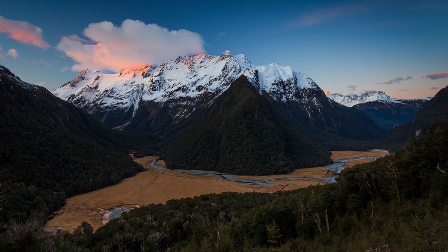 Humboldt Mountains on the Routeburn Track, South Island of New Zealand Clouds High Up Hiking Hiking Humboldt Mountains Landscape Mountain Mountain Peak Mountain Range Mountains New Zealand Night No People Outdoors Routeburn Track Sky Snow South Island Sunset