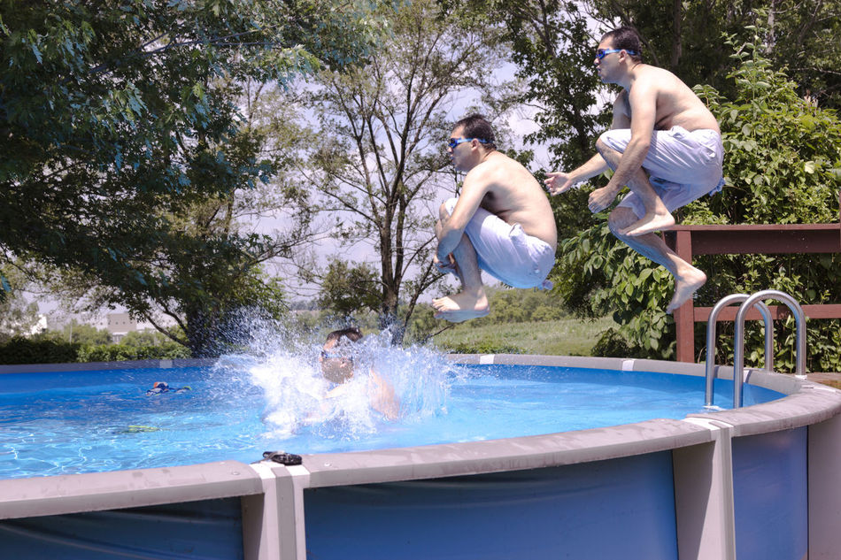 Jumping In! Carefree Enjoyment Escapism Fun Hotel Jumping Leisure Activity Men Real People Side View Summer Summertime Swimming Swimming Pool Timelaspe Water Weekend Activities