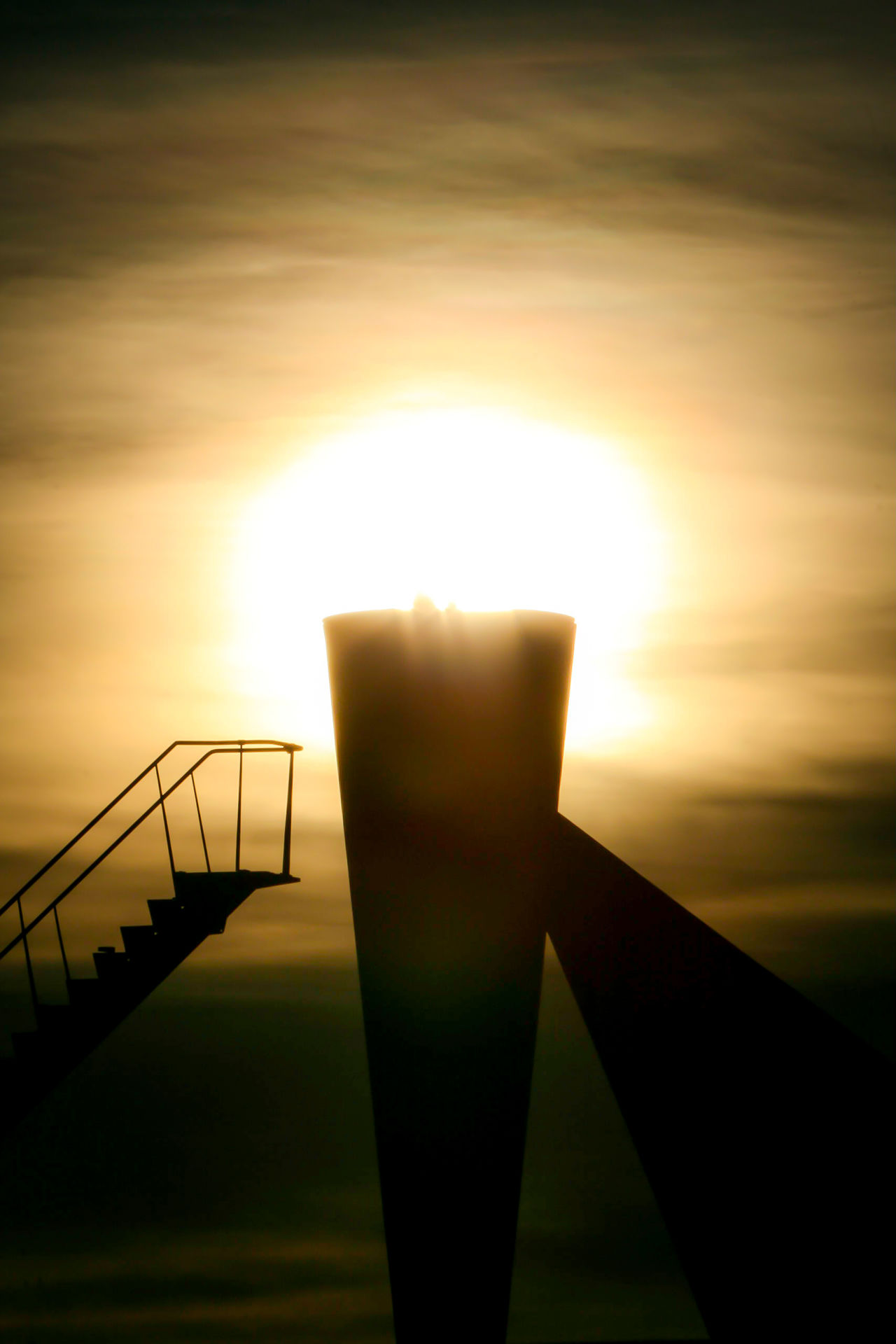 The olypic flame of lillehammer is still burning. Day Lens Flare Nature No People Olympia Olympic Olympic Fire Olympic Flame Olympic Stadium Olympicgames Olympics Olympisches Feuer Outdoors Silhouette Sky Steps Sun Sunbeam Sunlight Sunset Sunset Silhouettes Sunset_collection Tranquility