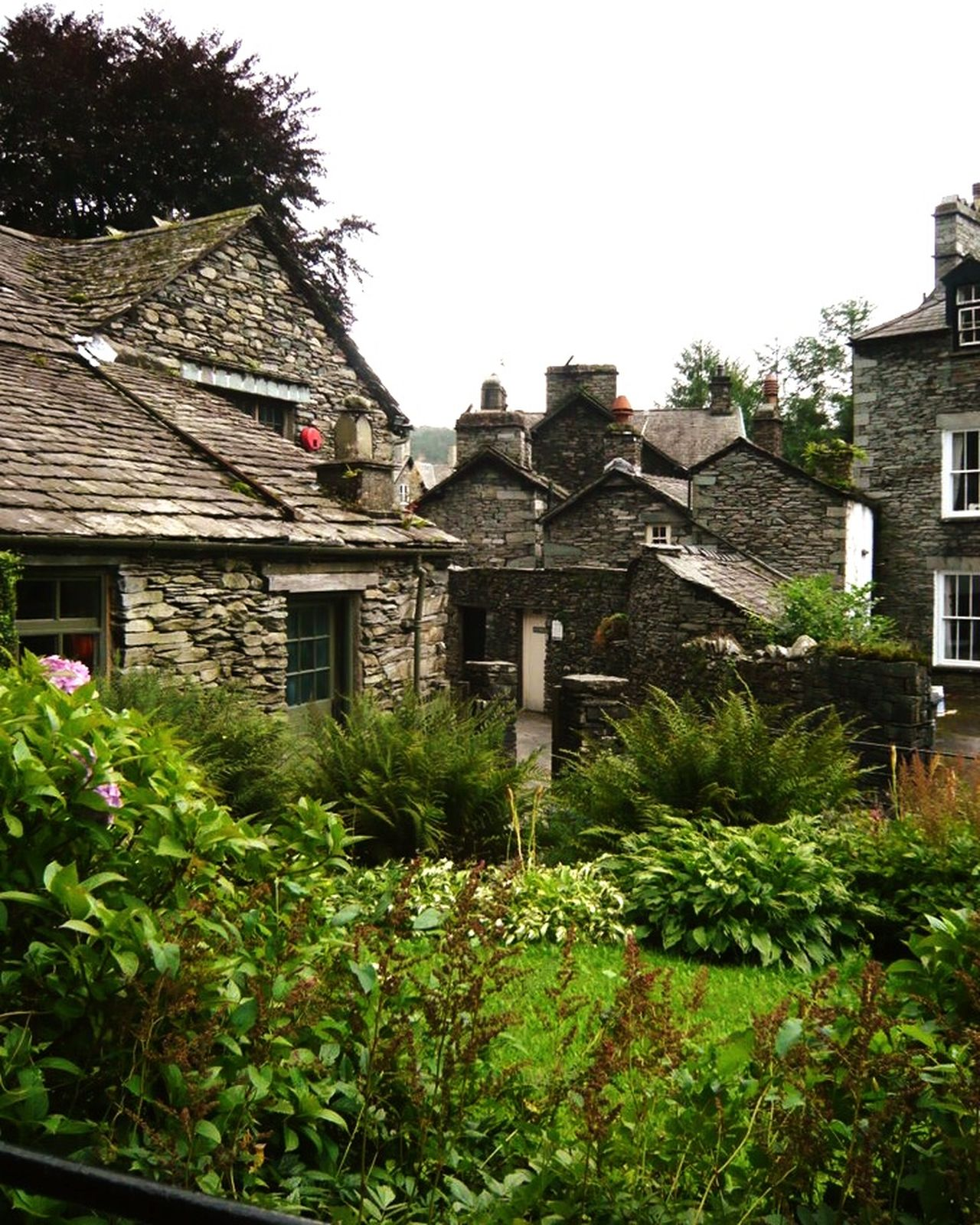 Lake District , England , Summer Cottage - isn't it like a Fairytale  ? Spring Small House Old Buildings Stone Houses  Cottage Grassmere English Countryside England, UK Grey Day