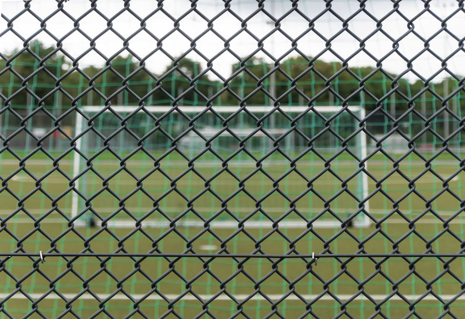 Chainlink Fence Close-up Fence Focus On Foreground Football Field Football Stadium Full Frame Fußballplatz Goal Maschendrahtzaun Mesh Wire Fence Protection Safety Security Tor Zaun Battle Of The Cities