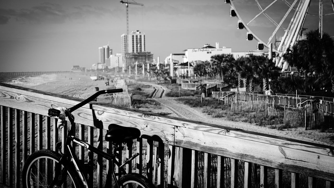 Stopping for a rest. Bicycle Built Structure Transportation Mode Of Transport Architecture City Land Vehicle Building Exterior Travel Travel Destinations Sky Day Outdoors Water Cityscape No People Blackandwhite Black And White Photography