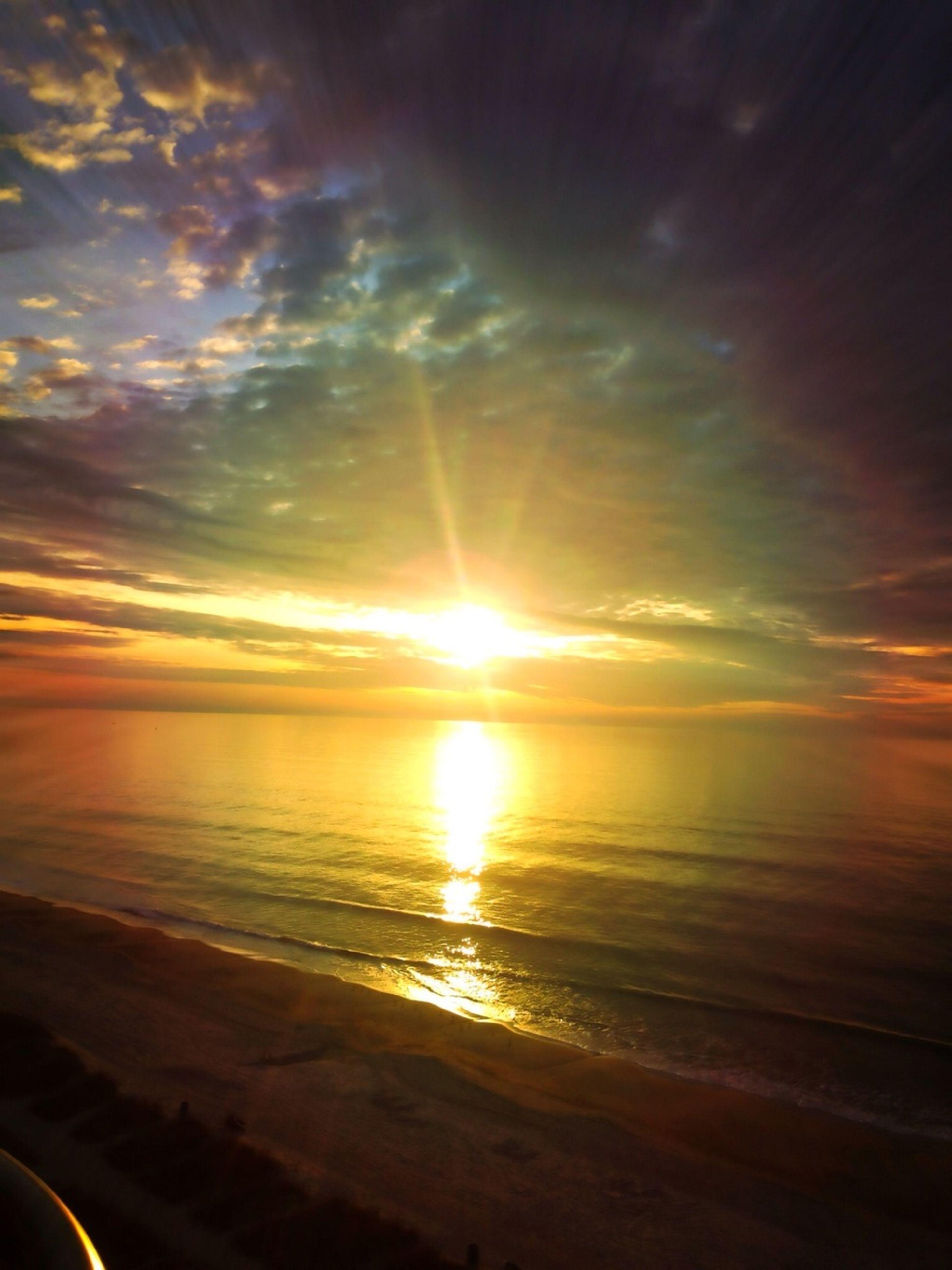 sunset, sea, horizon over water, sun, beach, water, scenics, beauty in nature, tranquil scene, sky, shore, tranquility, reflection, idyllic, orange color, nature, sunlight, cloud - sky, sunbeam, sand
