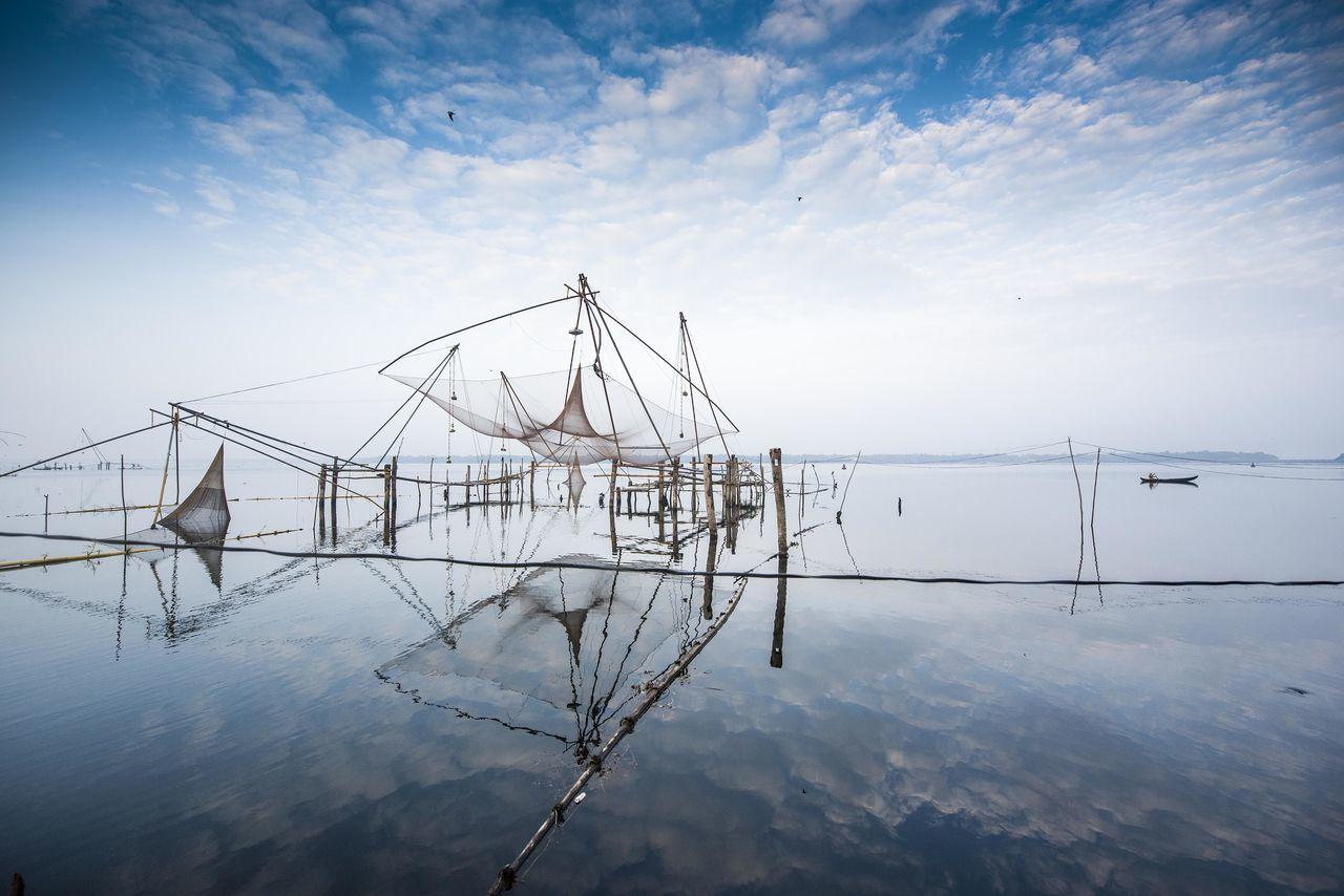 Calmness Chinese Net Environment Fishing Fishing Net India Kerala Kerala The Gods Own Country ;) Kumarakom Lake] Nature No People Outdoors Reflection Sky Still Water Tourism Tranquility Water
