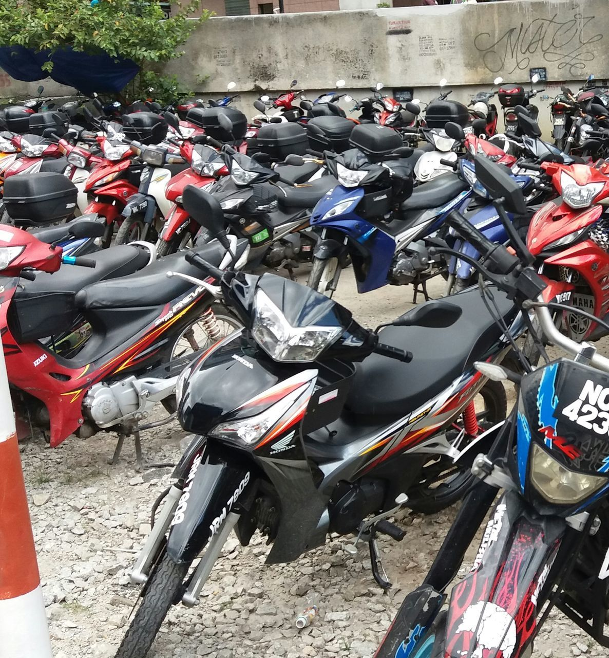 transportation, mode of transport, stationary, land vehicle, bicycle, motorcycle, day, outdoors, parking, scooter, no people, bicycle rack