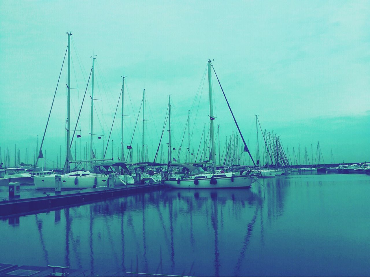 water, reflection, transportation, nautical vessel, no people, moored, mode of transport, outdoors, sky, day, waterfront, harbor, tranquility, mast, blue, nature, sailboat, beauty in nature, yacht, architecture