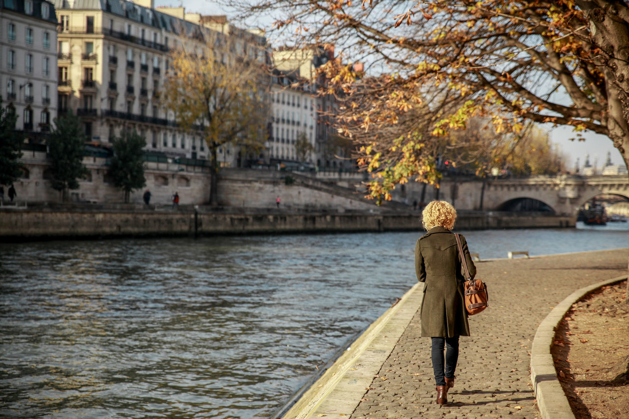 Alone Autumn Autumn Colors Back View Buildings Curly Hair Girl La Seine River Seine Seine River Sunny Day Tree Branches Walking Alone... Women Who Inspire You People And Places Exploring Style