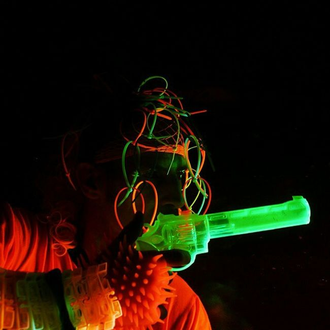 A friend Matthew Cotter posed for this blacklight shoot Blacklight Neon Gun Techno Austin ATx Glow