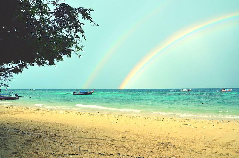 Sea Rainbow Water Beauty In Nature Beach Scenics Nature Multi Colored Horizon Over Water