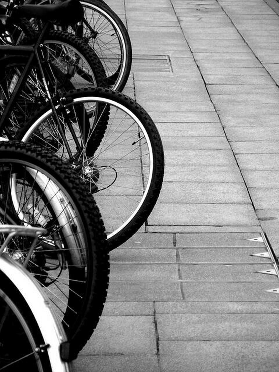 bicycle, transportation, mode of transport, land vehicle, stationary, wheel, day, outdoors, bicycle rack, spoke, tire, no people