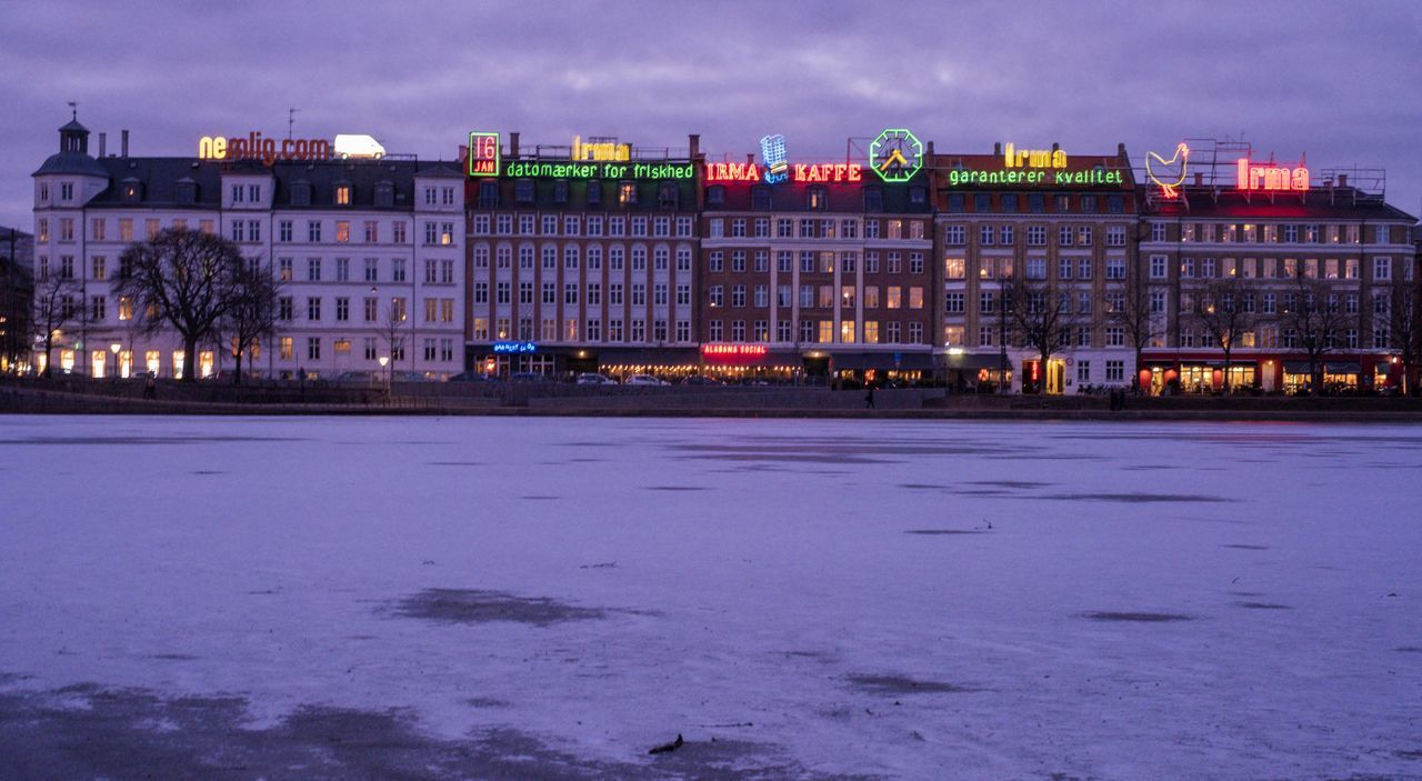 building exterior, architecture, built structure, winter, night, cold temperature, illuminated, snow, outdoors, sky, no people, nature, water, city