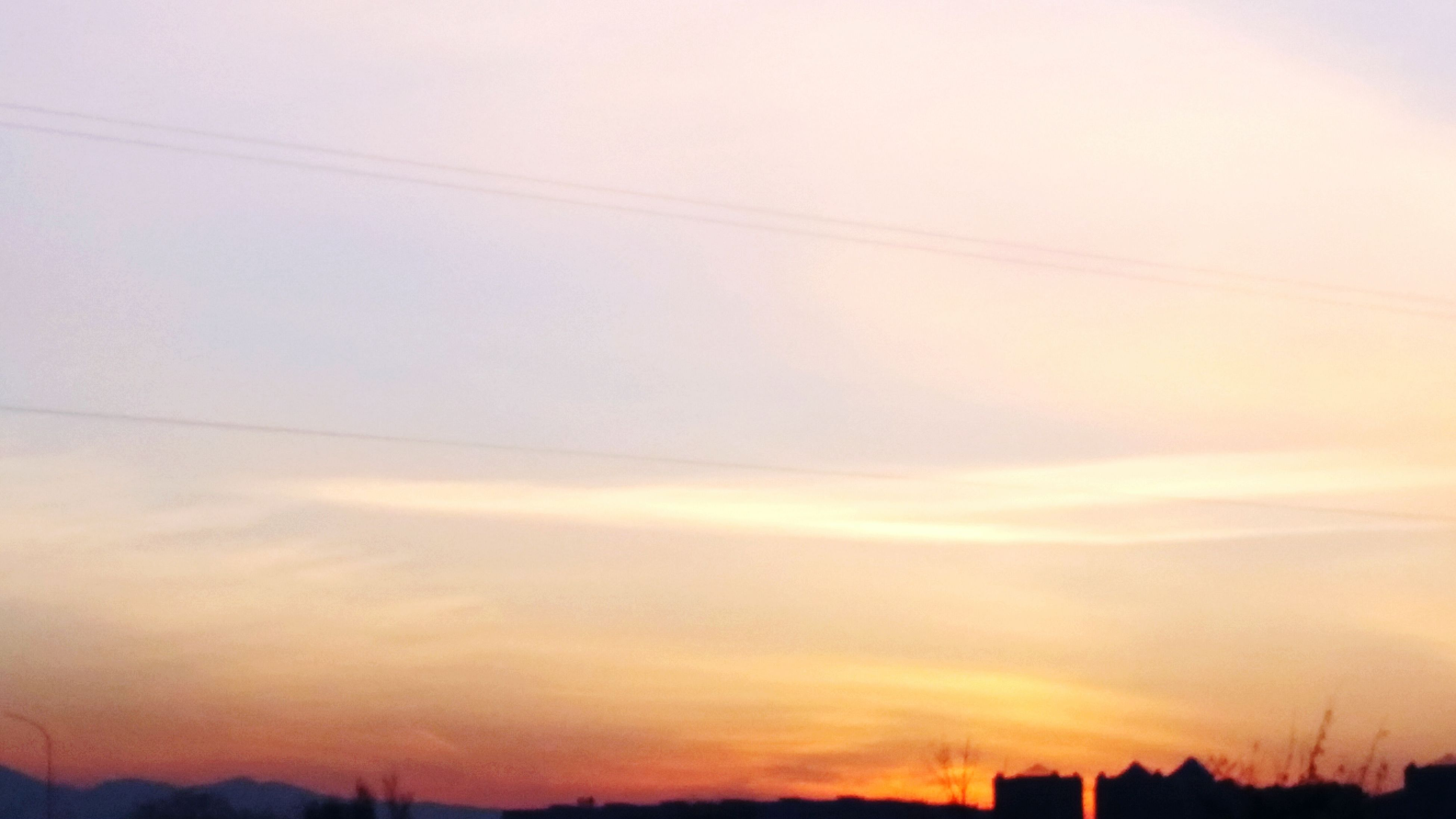 sunset, power line, silhouette, sky, scenics, electricity pylon, tranquil scene, tranquility, beauty in nature, orange color, cable, electricity, power supply, nature, low angle view, connection, landscape, idyllic, outdoors, no people