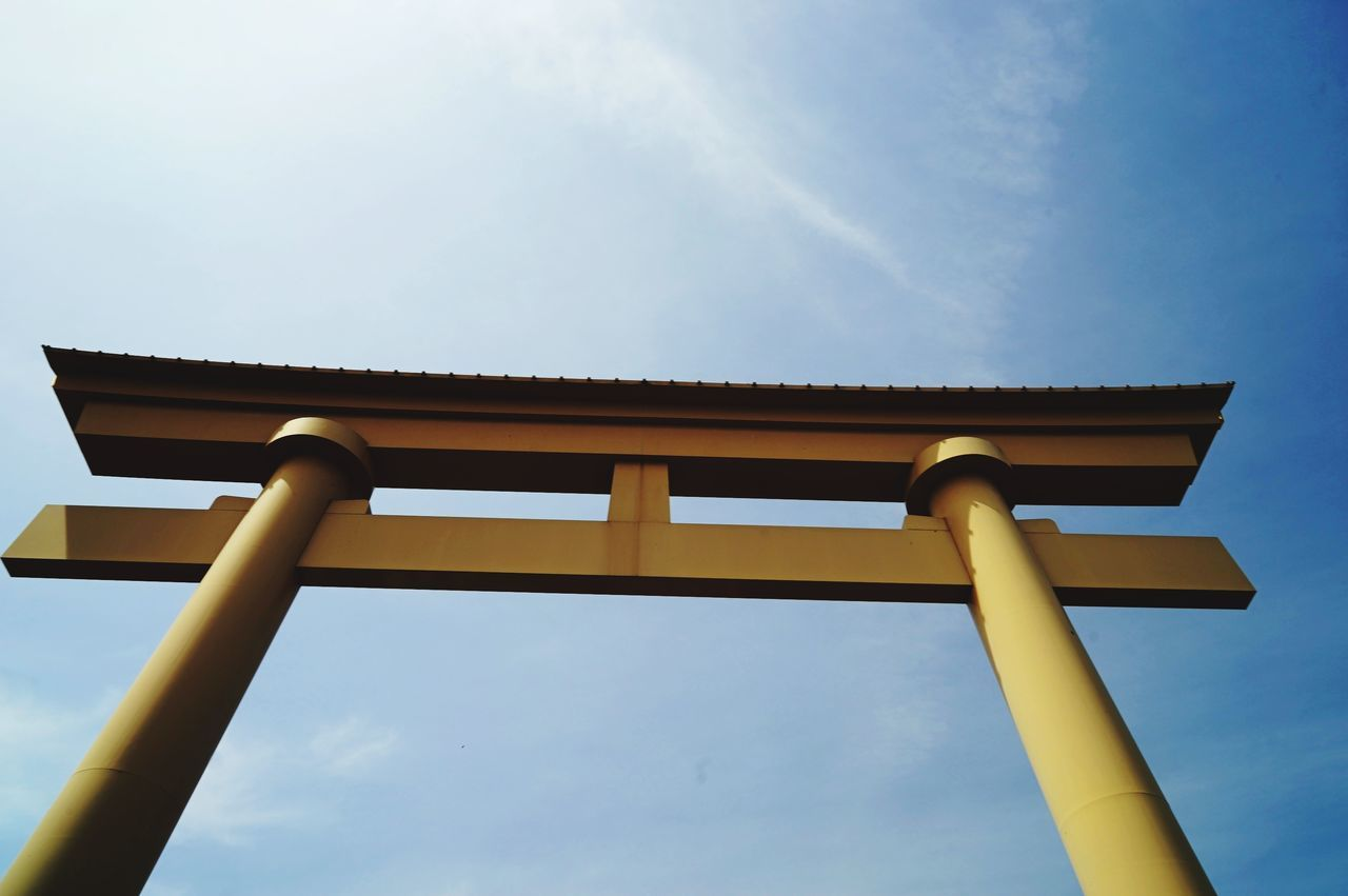 low angle view, sky, outdoors, day, blue, built structure, no people, architecture, nature