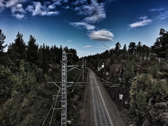 Tree Transportation High Angle View The Way Forward Road Sky Connection Railroad Track Diminishing Perspective Vanishing Point Blue Day Outdoors Railway Track Nature Journey Cloud - Sky Straight Long Empty Road