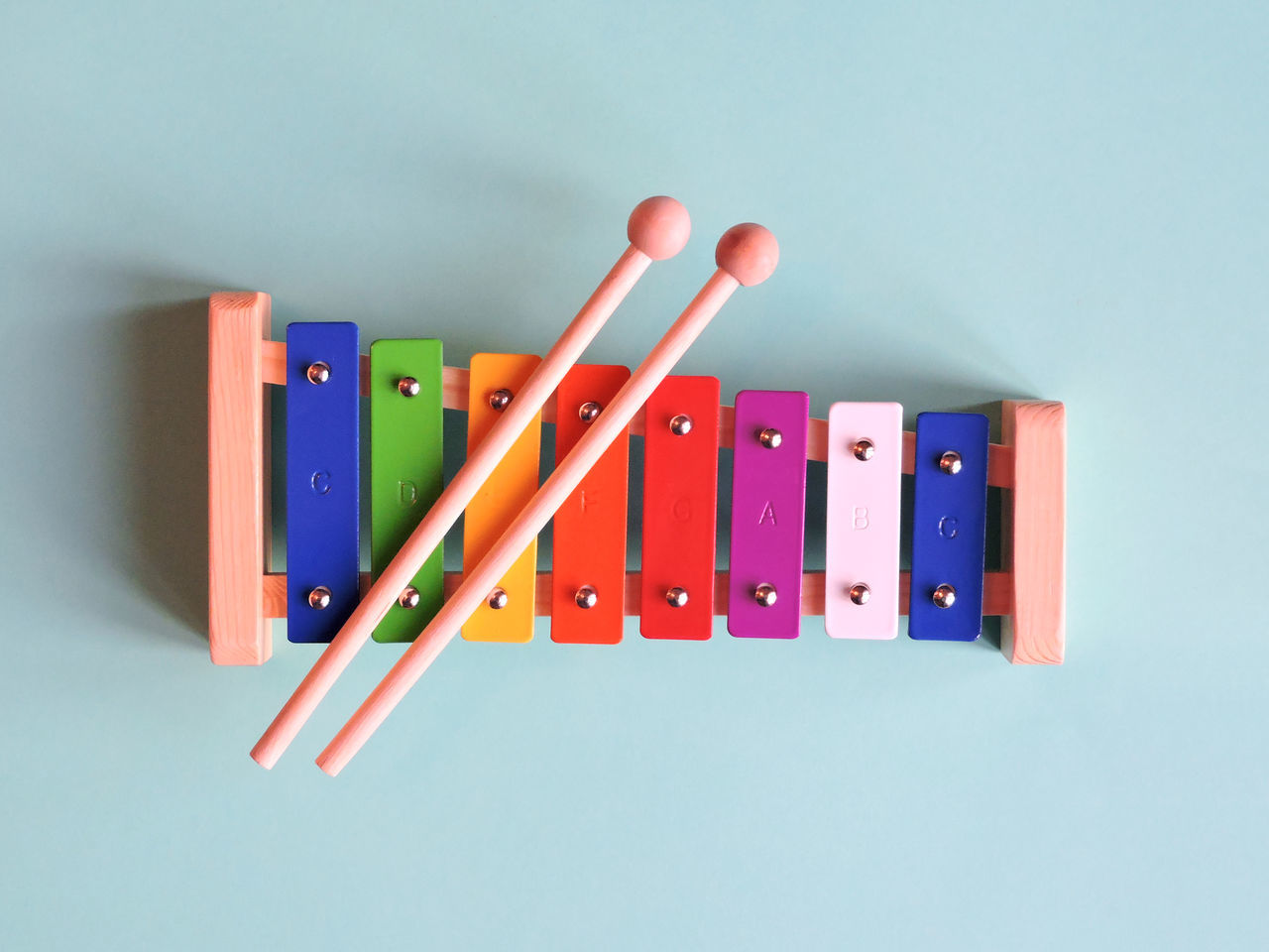 Above View Blue Background Minimal Studio Toy Xylophone