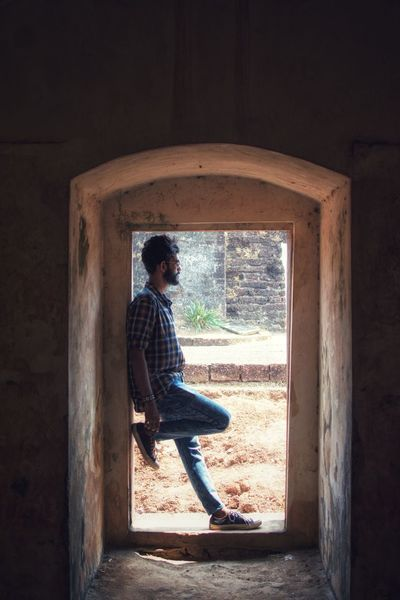 EyeEm Best Shots The Week on EyeEm Light And Shadow Shadow Abstract Looking Away St Angelo's Fort Kannur Potrait Full Length Adult One Person Leisure Activity Sitting People Window Adults Only Men Indoors  Architecture One Man Only Young Adult Only Men Nature Lifestyles Day