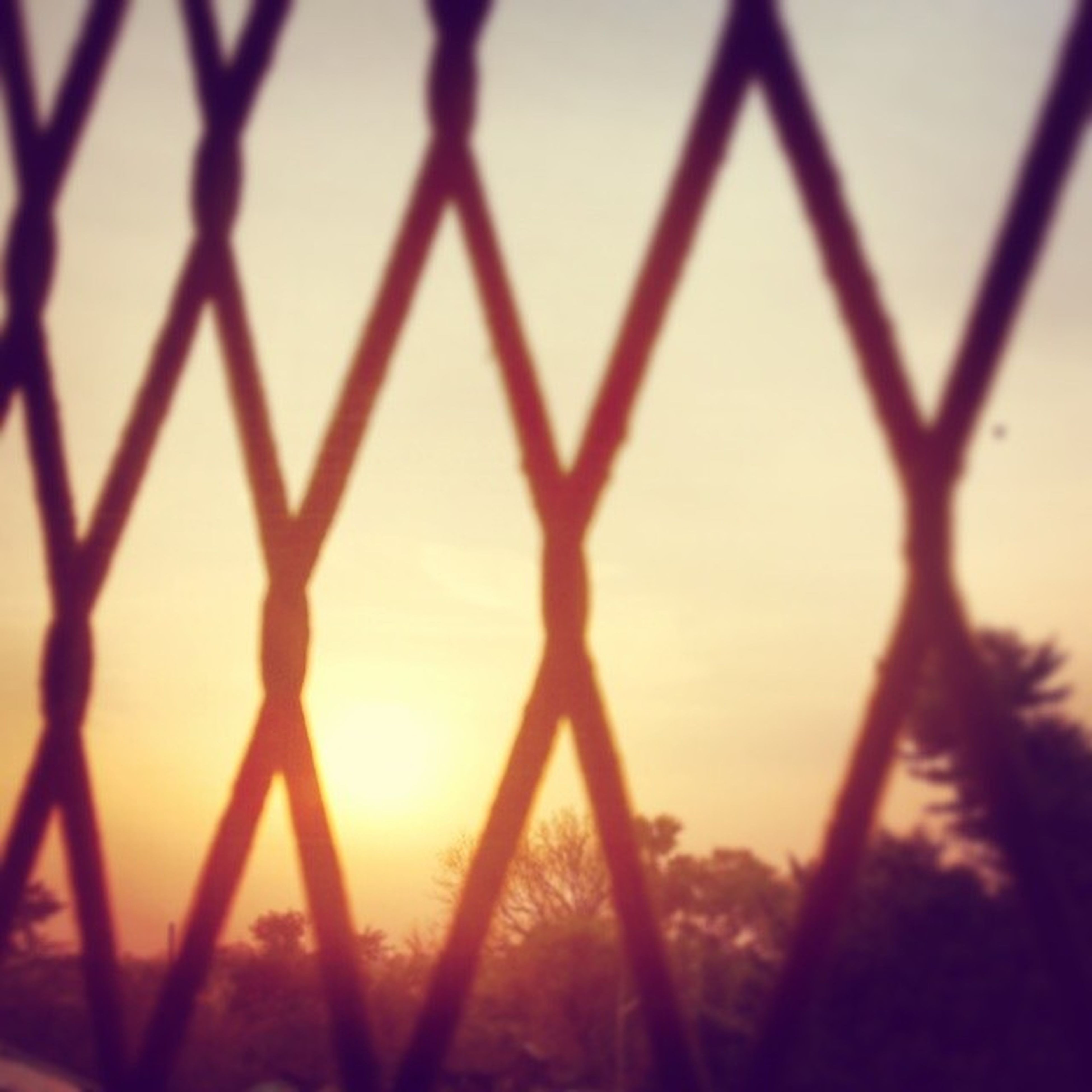 sunset, fence, metal, orange color, protection, chainlink fence, safety, sky, sun, silhouette, sunlight, focus on foreground, security, metallic, close-up, nature, tranquility, no people, outdoors, beauty in nature