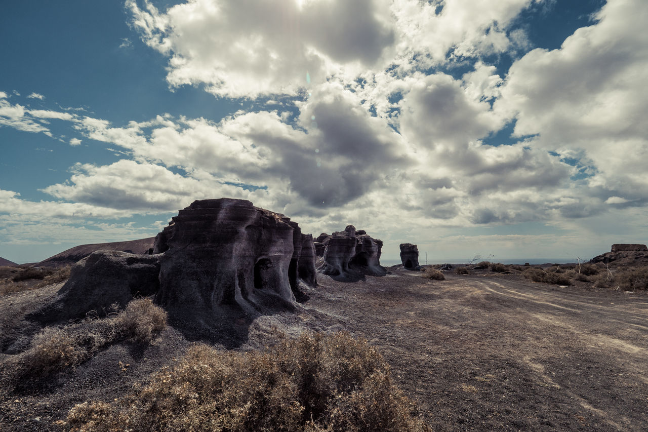 Special rocks on Lanzarote with a cloudy sky in direct sunlight Arid Climate Beauty In Nature Cloud - Sky Day Desert Landscape Nature No People Outdoors Physical Geography Rock - Object Scenics Sky Tranquil Scene Tranquility Travel Destinations