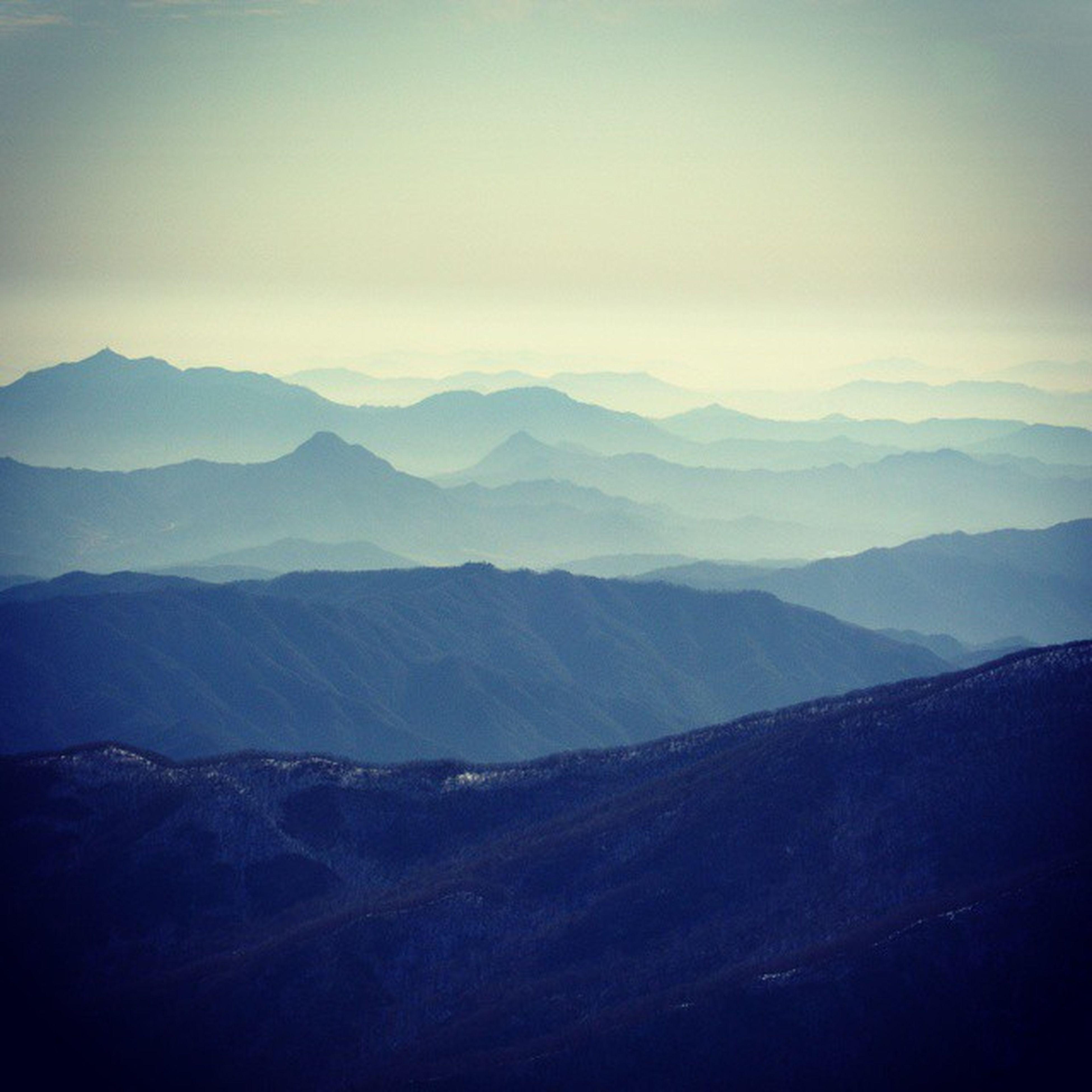 mountain, mountain range, tranquil scene, tranquility, scenics, landscape, beauty in nature, sky, nature, non-urban scene, idyllic, remote, outdoors, no people, cloud - sky, day, cloud, non urban scene, majestic, fog
