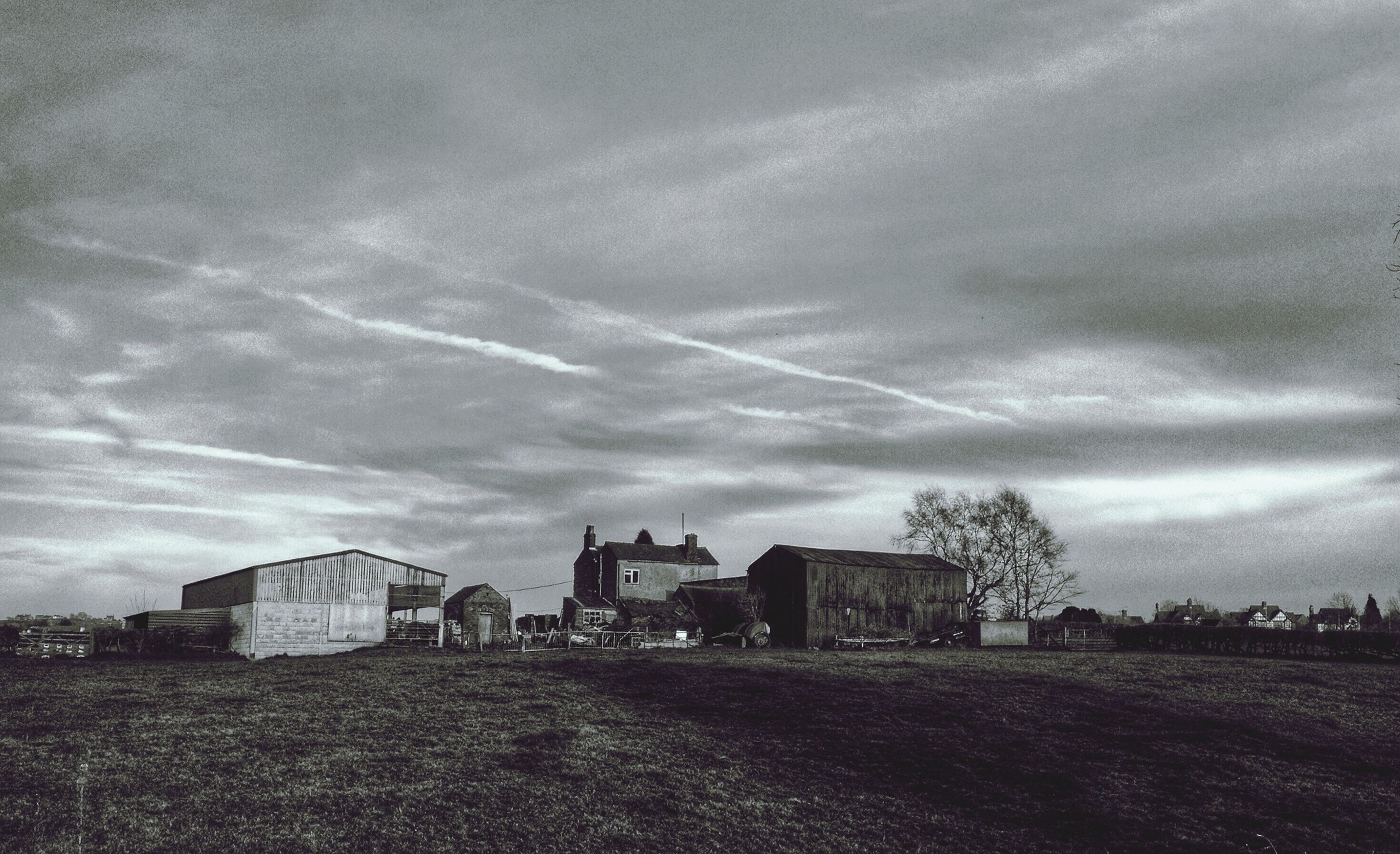 building exterior, architecture, built structure, sky, field, house, grass, cloud - sky, rural scene, landscape, tree, residential structure, cloud, agriculture, farm, nature, cloudy, village, day, barn