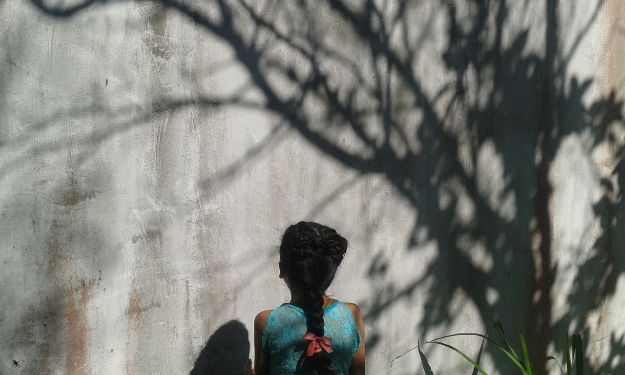 rear view, real people, lifestyles, one person, day, tree, leisure activity, women, outdoors, men, bare tree, nature, adult, people