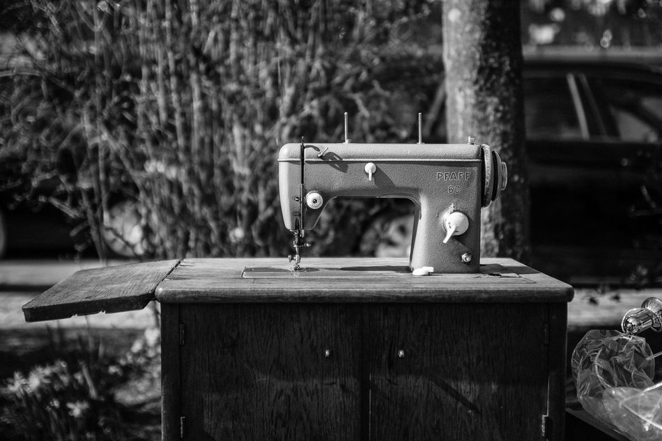 Blackandwhite Blackandwhite Photography Close-up Day Flea Markets Fleamarket Focus On Foreground No People Outdoors Pfaff Sewing Sewing Machine Sun Table Technology Tree