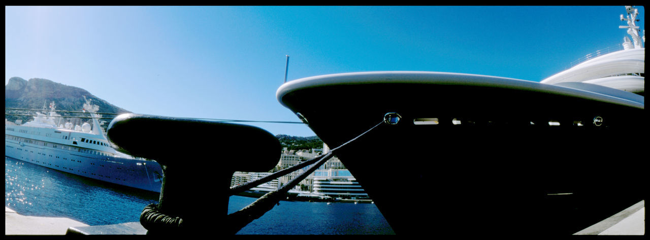 Summer in Monaco 35mm Analogue Photography Architecture Art Boat Colour Crane Côte D'Azur Harbour Monaco Monte Carlo Panoramic Panoramic Photography Rich Silhouette Sky Statue Summer Swimmer Statue Travel Trip Water Wealth Yacht