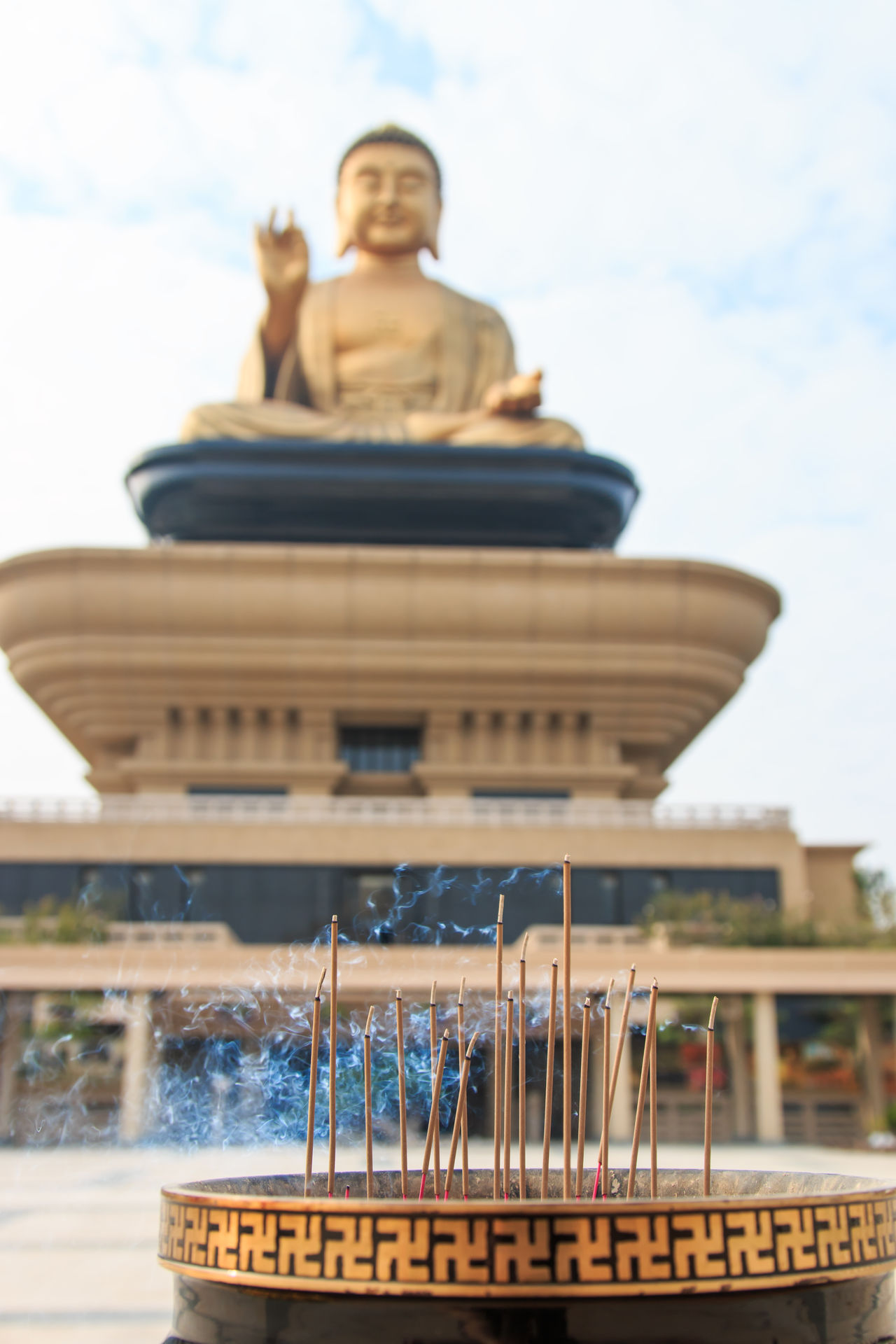 Kaohsiung, Taiwan - December 15,2014: Giant buddha and incense at the Fo Guang Shan of Taiwan, Kaohiung Architectural Column Art ASIA Asian  Asian Culture Buddha Buddha Statue Cloud Cloud - Sky Day Fo Guang Shan Focus On Foreground Kaohsiung Low Angle View No People Outdoors Religion Sky Summer Taiwan Tourism Tradition Travel Destinations