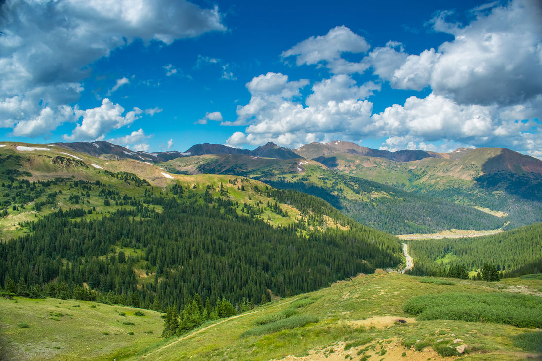 Continental Divide, Loveland Pass Continental Divide Loveland Pass Beauty In Nature Cloud - Sky Day Green Color Landscape Mountain Mountain Range Nature No People Outdoors Scenics Sky Tranquil Scene Tranquility