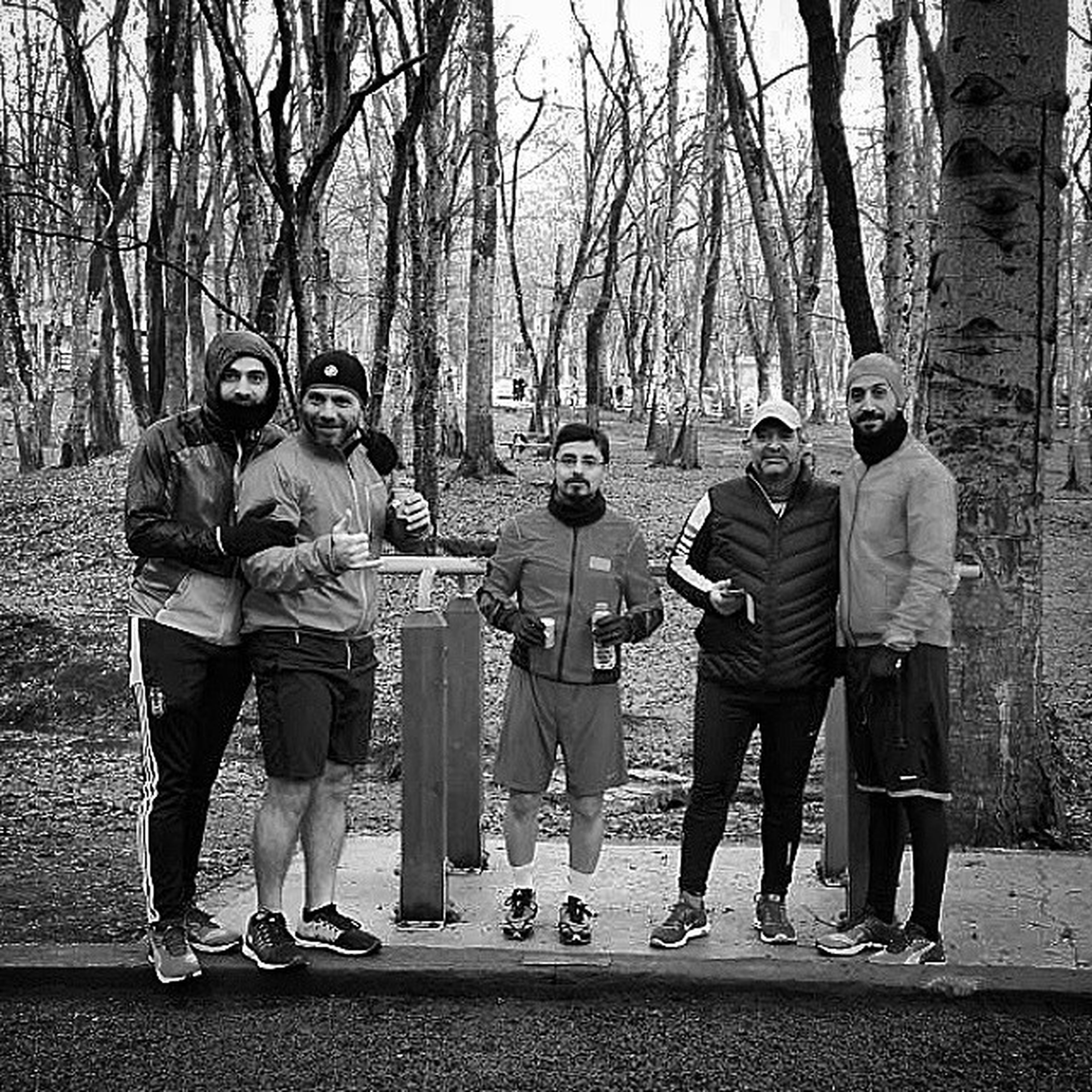 casual clothing, togetherness, lifestyles, full length, tree, childhood, leisure activity, men, standing, boys, street, girls, love, bonding, person, walking, day, rear view
