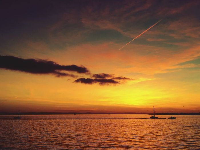 Sunset Sea Scenics Sky Beauty In Nature Water Tranquility Tranquil Scene Cloud - Sky Silhouette No People Horizon Over Water Outdoors Nautical Vessel Travel Destinations