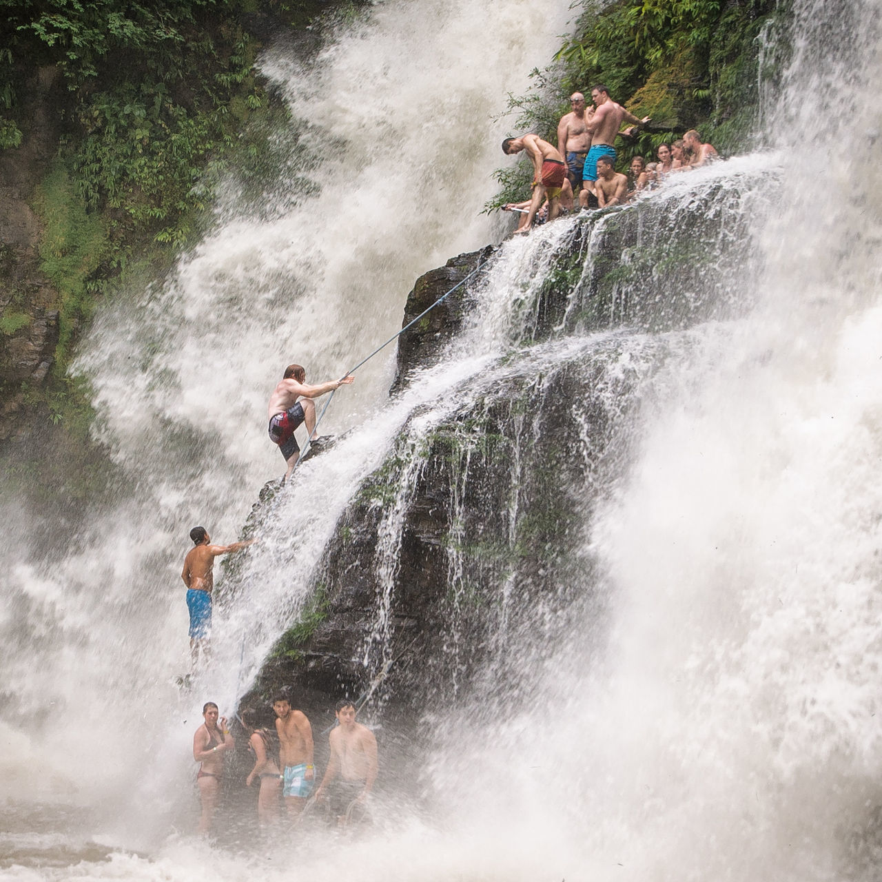 motion, fun, water, splashing, adventure, men, leisure activity, togetherness, day, speed, river, waterfall, real people, enjoyment, risk, outdoors, sitting, group of people, boys, friendship, nature, young adult, people, adult