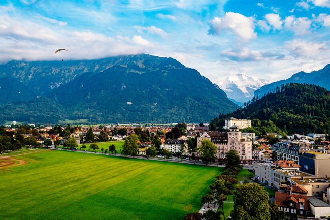 Architecture Beauty In Nature Blue Building Exterior Built Structure Cloud - Sky Day Farm Green Color Growth Interlaken Jungfrau Jungfrau - Top Of Europe Landscape Mountain Mountain Range Nature Scenics Sky Switzerland Town Tranquil Scene Tranquility Travel Destinations Tree