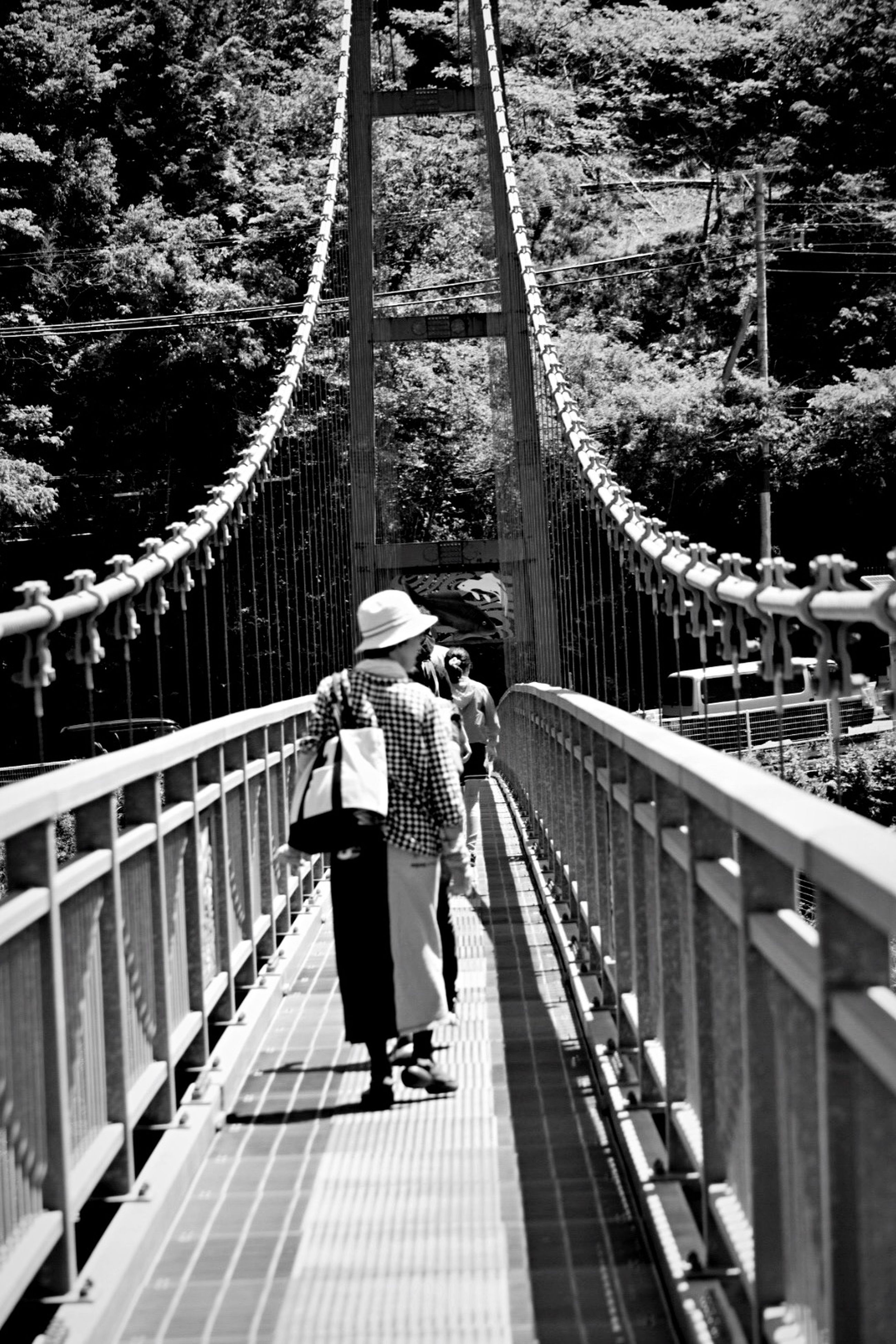 full length, lifestyles, casual clothing, rear view, leisure activity, railing, walking, the way forward, togetherness, childhood, boys, men, girls, bridge - man made structure, family with one child, bonding, love