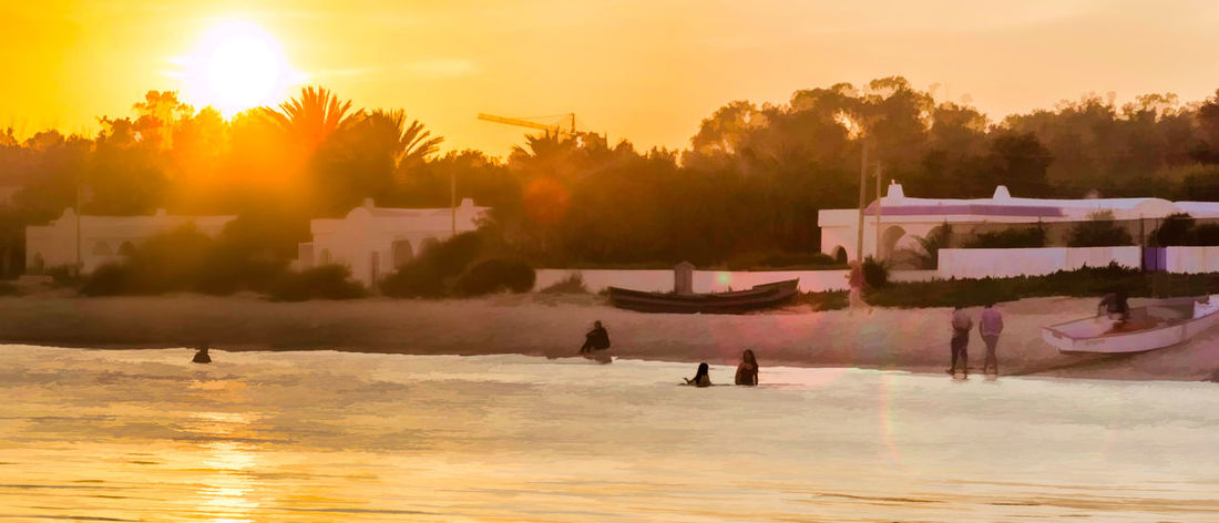 Nabeul's Beach Paint like Beach Beauty In Nature Cultures Day Large Group Of People Nabeul Nabeul Tunisia Nature Outdoors Paint Brush Palm Tree People Sky Summer Sun Sunlight Sunset Tourism Travel Travel Destinations Tree Vacations Water