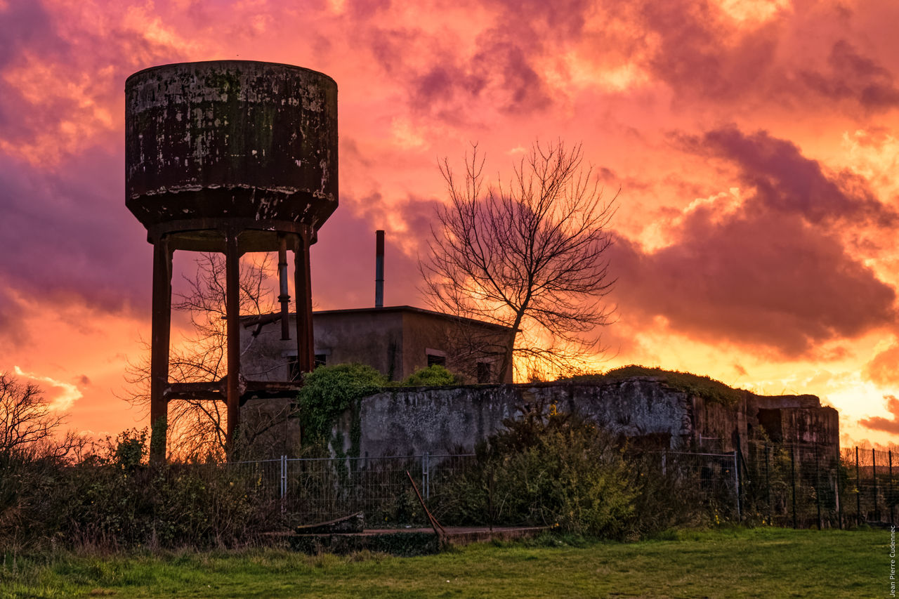 Silhouette Built Structure Against Dramatic Sky During Sunset