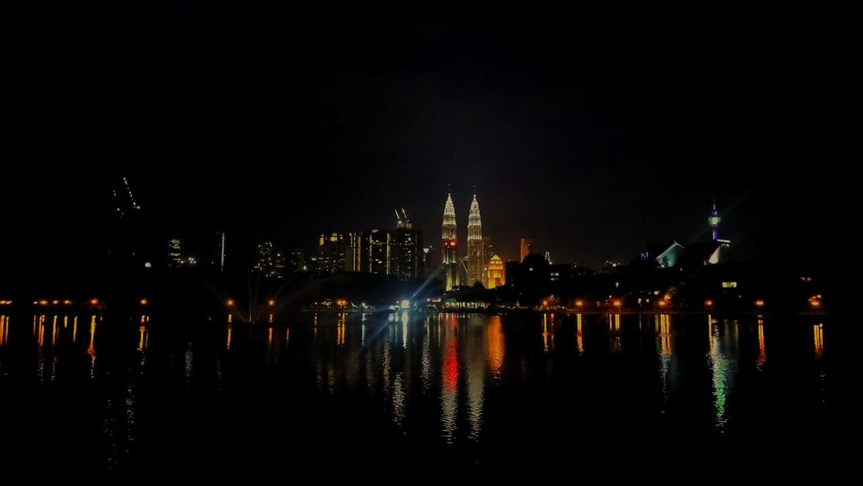 Indochina Malaysia Kualalumpur Petronastower Night Reflection Illuminated Cityscape City Arts Culture And Entertainment Business Finance And Industry No People Celebration Awe Outdoors Travel Destinations Multi Colored Urban Skyline Nightlife Sky Water Architecture