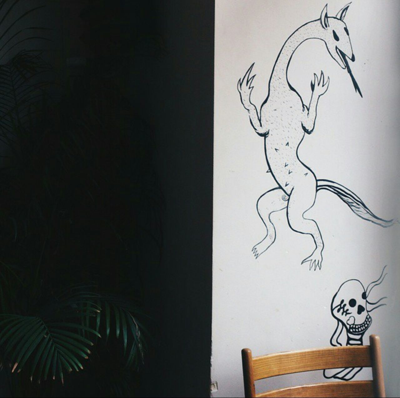Skull illustration Indoors  Drawing - Art Product No People Home Interior Tree Close-up Day Interior Design Sketch Skull Monster Illustration Art Wall Grafitti White Green Wood Black Paint Painting Cafe Palm Contrast