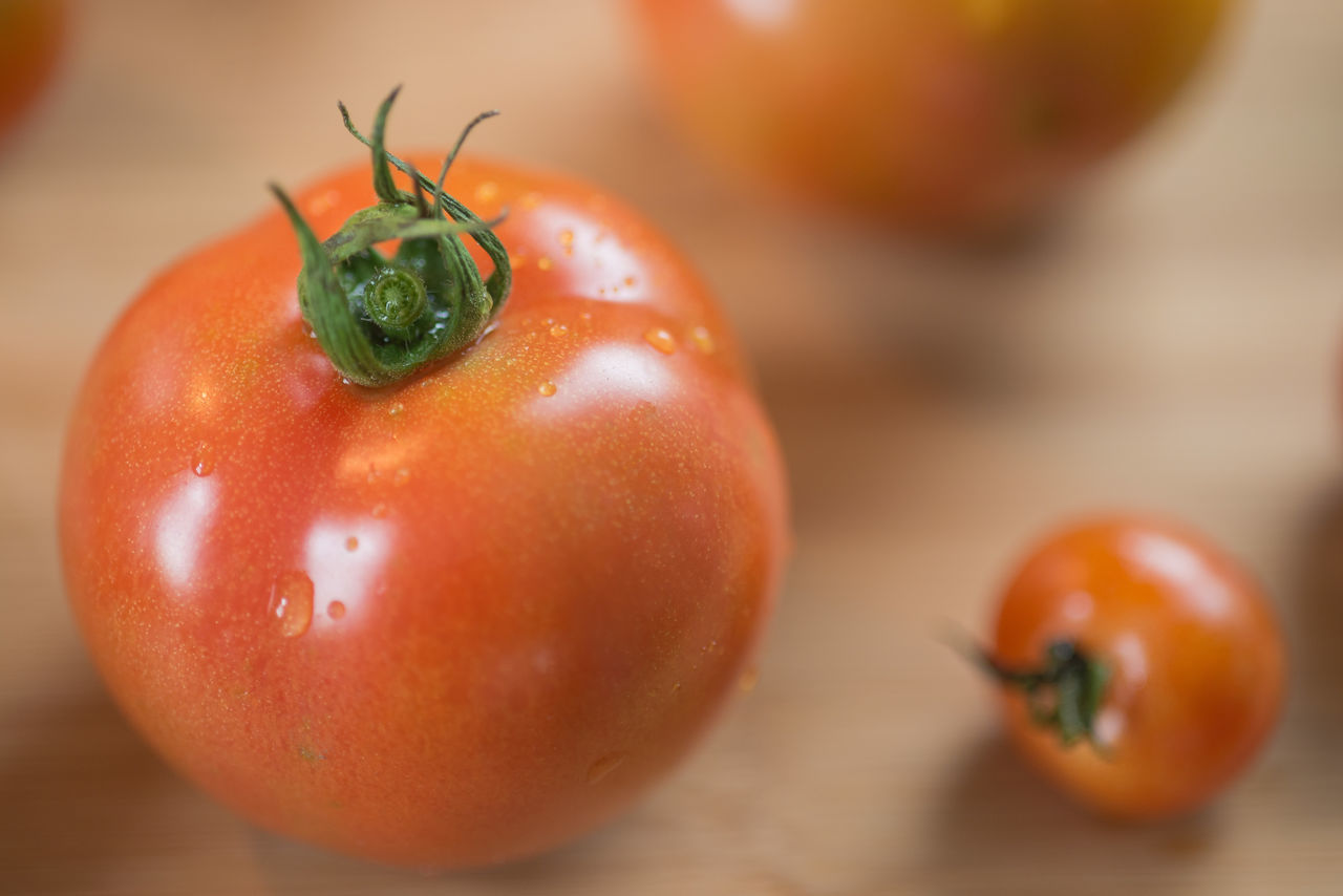 Close-Up Of Cherry Tomato On Cutting Board