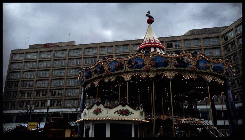 Carousel Notes From Babylon Horse Fair Amusement Park Sky And Clouds Lerone-frames Dunkelbunt Dark Photography Streetphotography