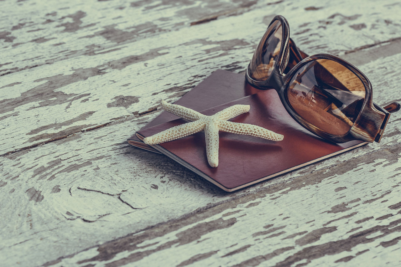 Passports with sunglasses with starfish on a wooden table. Concept of summer travel vacation tranquil and relaxing holiday Close-up Focus On Foreground Holiday Passports Selective Focus Starfish  Summer Summertime Sunglasses Table Travel, Vacation Vintage Wood - Material