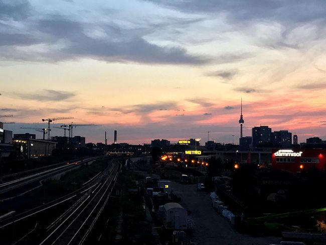 Transportation Sunset Cloud - Sky Sky Architecture Built Structure High Angle View Railroad Track Mode Of Transport Building Exterior City Land Vehicle Outdoors Travel Destinations No People Urban Skyline Cityscape Day