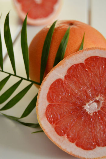 Fresh red grapefruit Healthy Eatings Palm Tree Backgrounds Blood Orange Citrus Fruit Close-up Food Food And Drink Fresh Fruits Freshness Fruit Fruit Juice Grape Juice Grapefruit Healthcare And Medicine Healthy Eating Healthy Lifestyle Indoors  Organic Red Grapes Redfruits SLICE White Wood