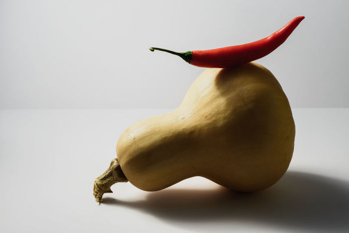 Butternut squash with red chili pepper Butternut Pumpkin Butternut Squash Cooking Copy Space Foodphotography Healthy Healthy Eating Healthy Lifestyle Ingredients Light And Shadow Nutrition Pumpkin Red Red Chili Pepper Red Pepper Squash Squash - Vegetable Still Life Still Life Photography Vegan Vegan Food Vegetable Vegetarian Vegetarian Food Vitamins